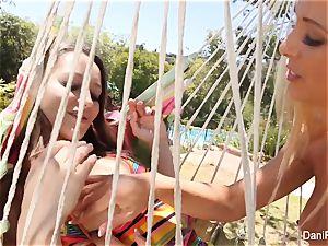 Dani and Cherie pummel on the hammock