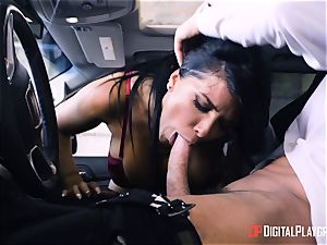 Romi Rain torn up in the back of the car