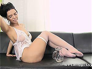 buxomy Elena Rae pees through her stocking