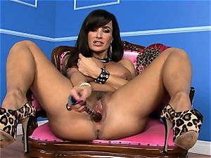 fantastic Lisa Ann sticks her dildo deep in her humid vag