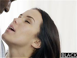 Megan Rain drilling a black meatpipe