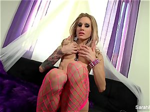 Sarah Jessie romps herself with a pink plaything